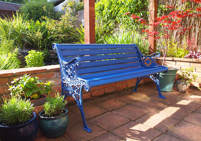 Blue garden bench in evening light