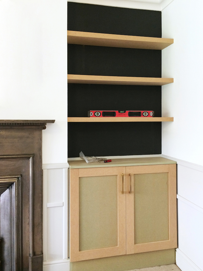 Built-in alcove shelves and cupboards