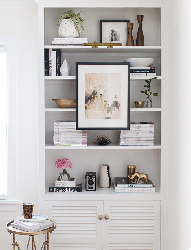 bookshelf-with-mounted-art