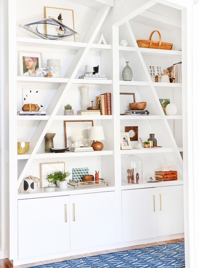 emily-henderson-artfully-styled-bookcase-in-neutral-tones