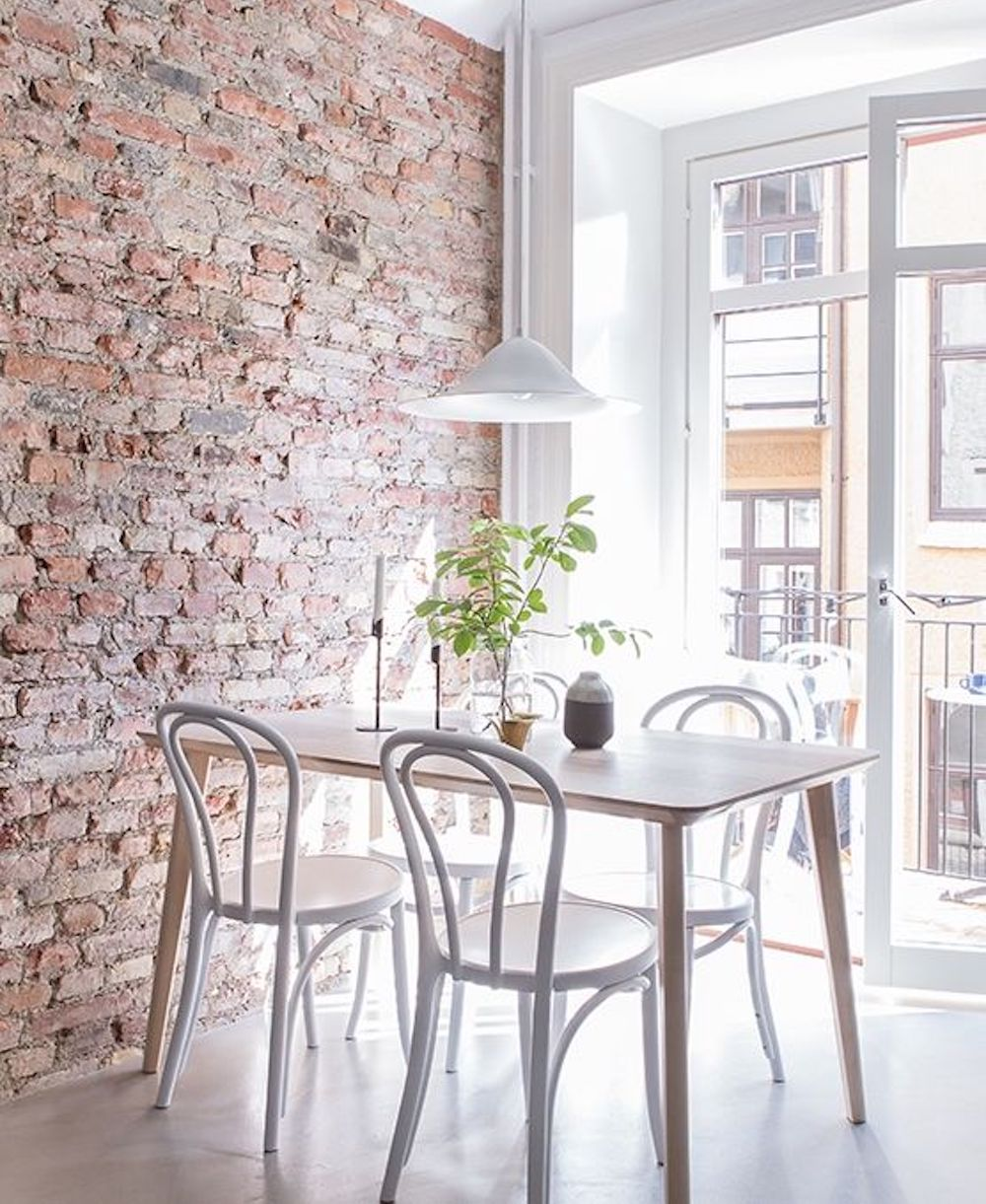 Dining area with exposed brick wall