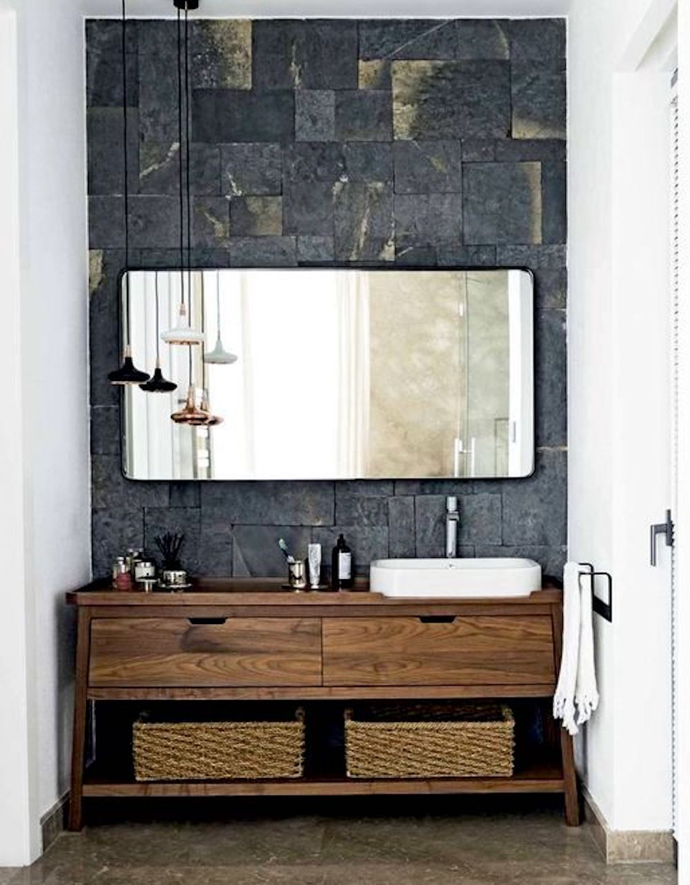 Making a feature of the wooden vanity using dark tiles as a backdrop