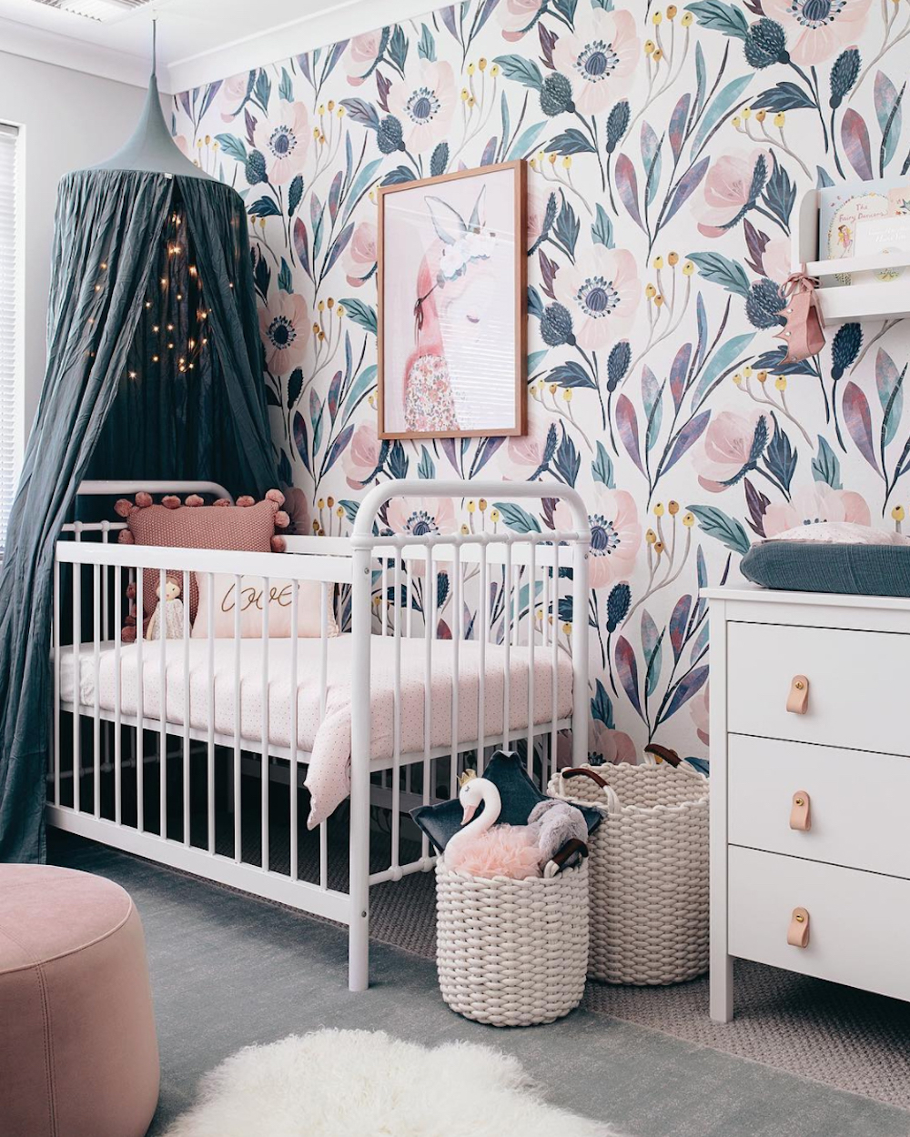 Nursery with feature wallpapered wall