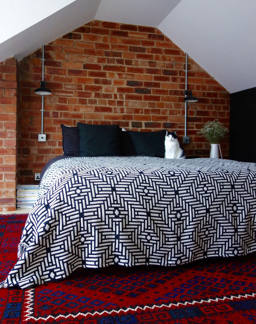 Exposed brick in loft bedroom