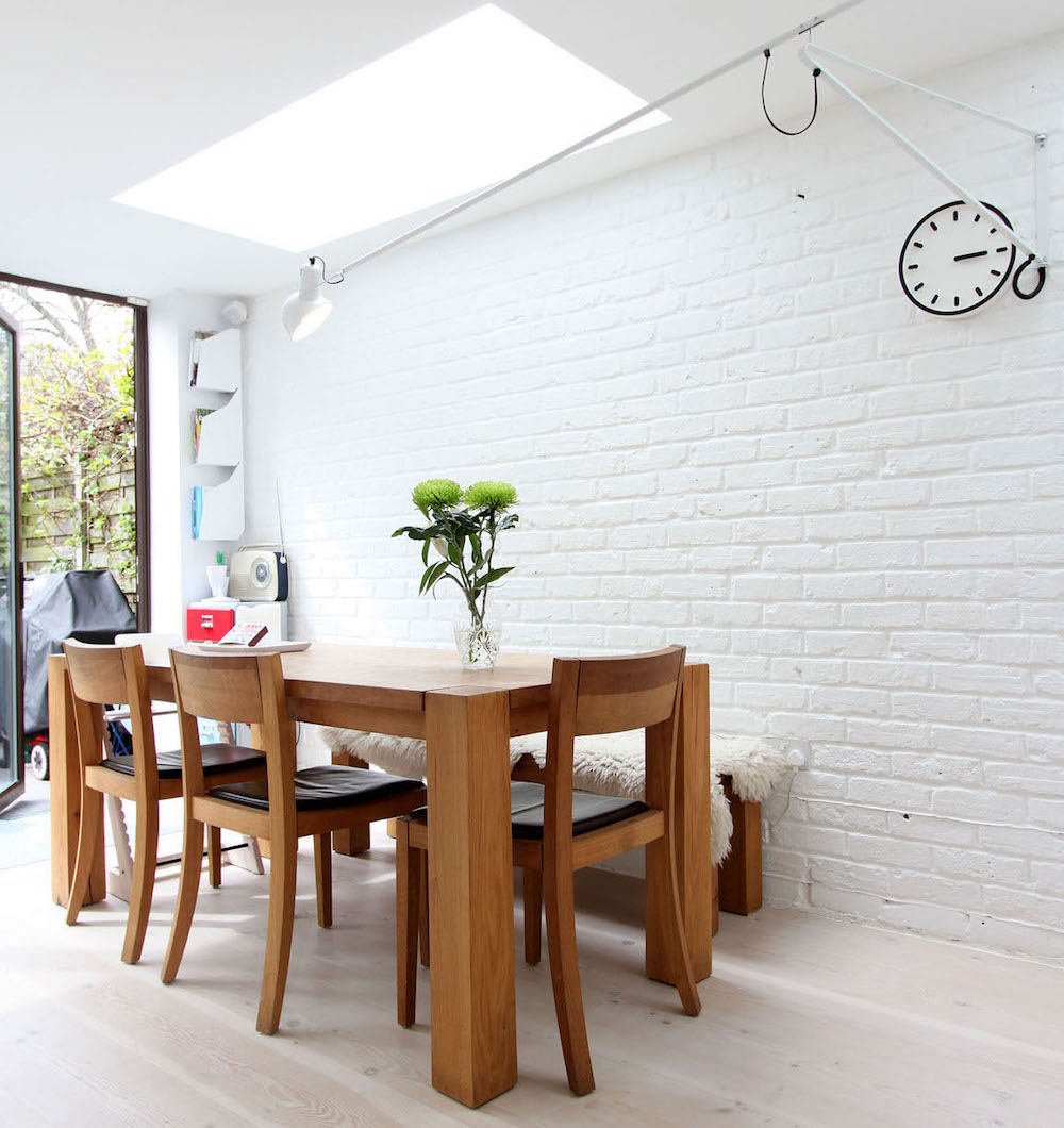 Dining space with a white brick wall