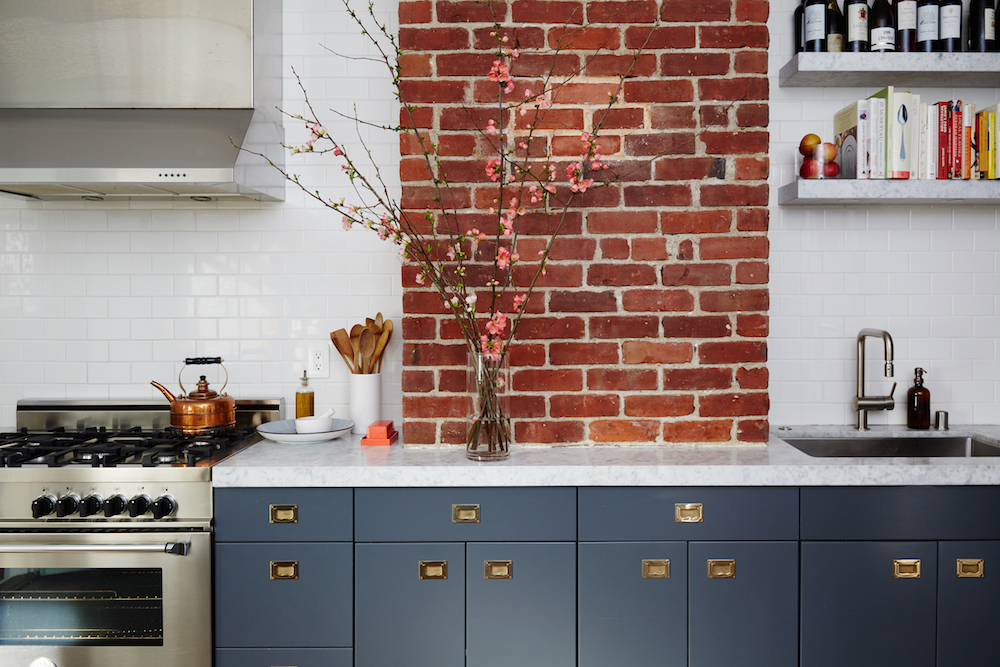 Kitchen with brick pier. Designed by Studio Muir