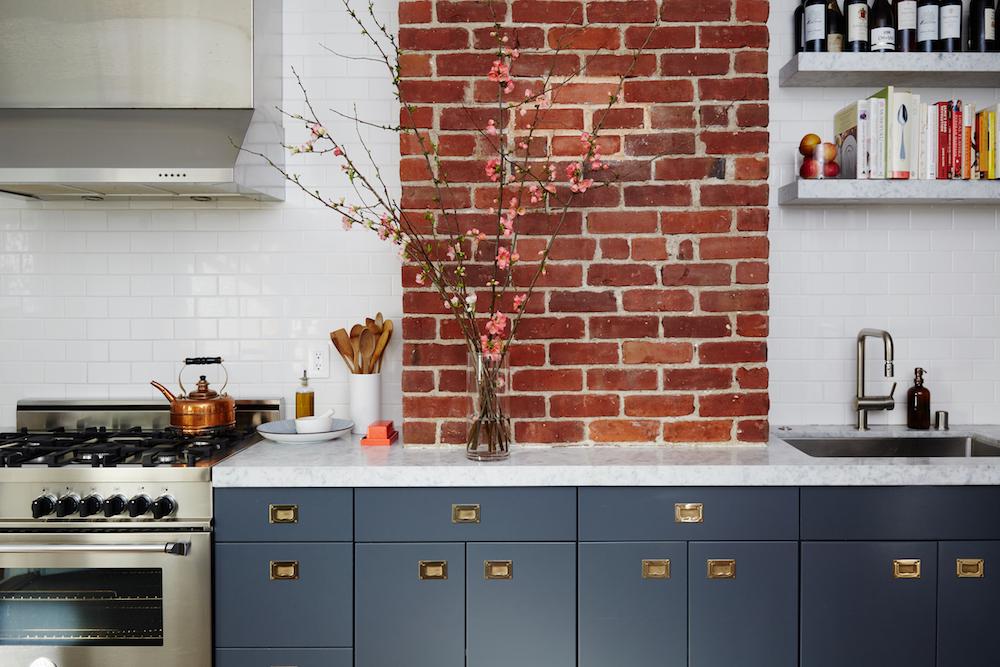 Kitchen with brick pier. Designed by Studio Muir