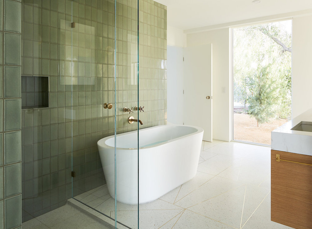 Bathroom with olive coloured tiles || Olive green colour inspiration by First Sense