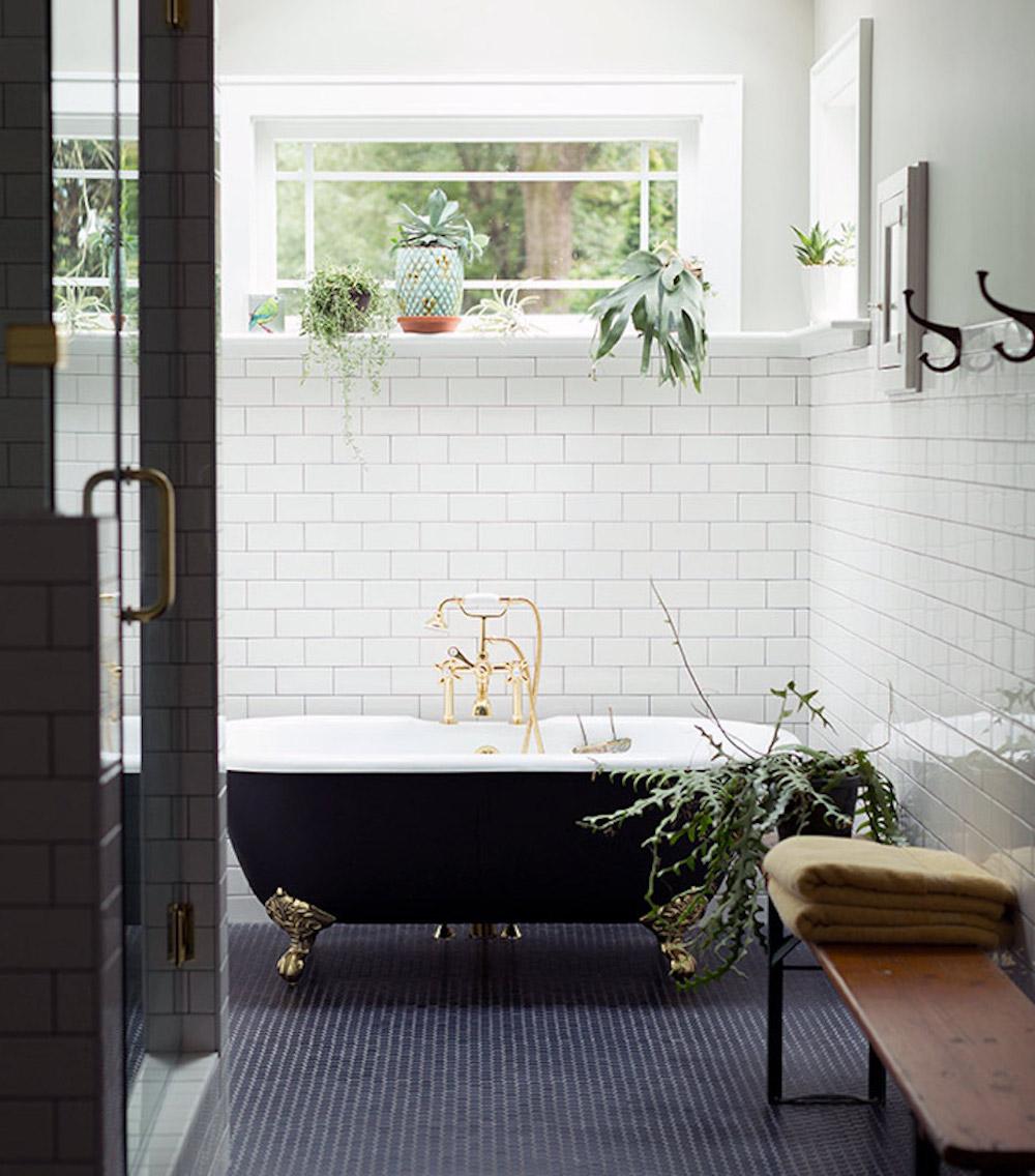 Bathroom renovation tips by First Sense || Statement black clawfoot bath, white metro tiles