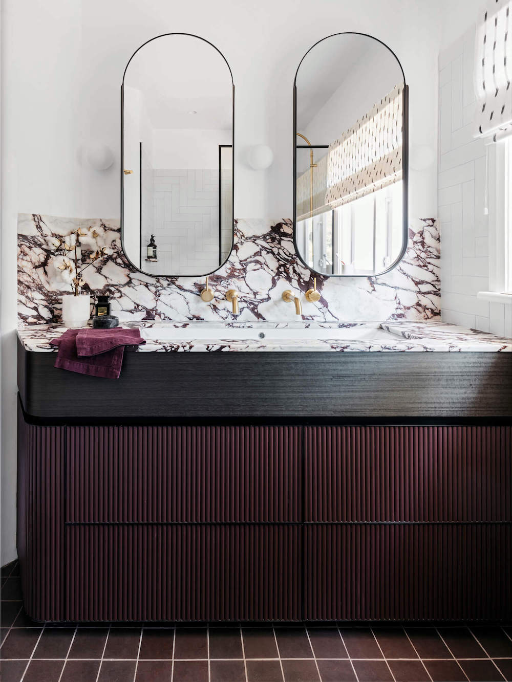 Deep burgundy marble-topped vanity || Bathroom renovation tips by First Sense