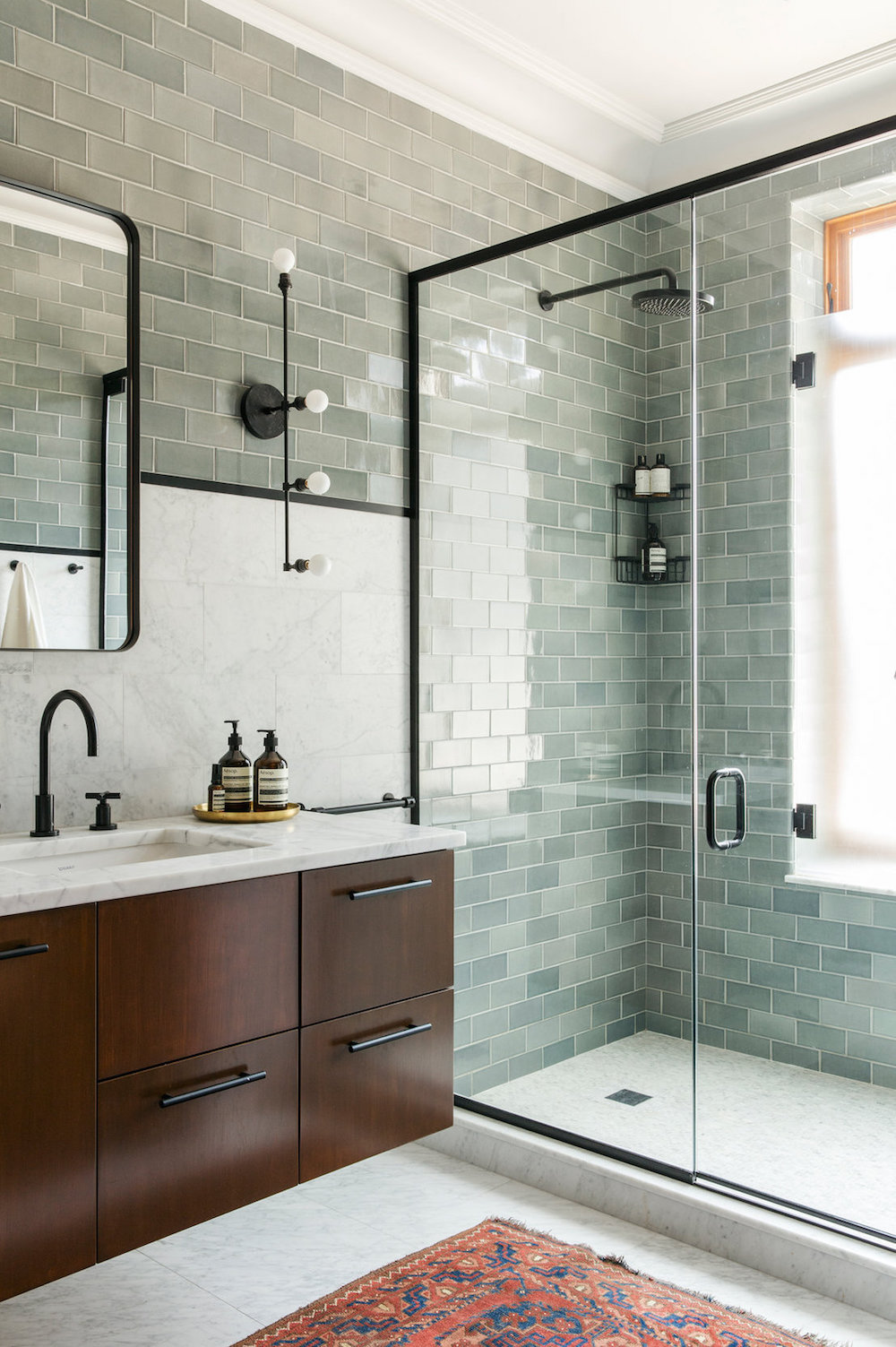 Bathroom renovation tips by First Sense || Marble tiles combined with glazed brick tiles