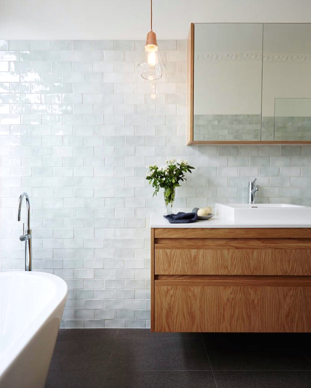 Bathroom renovation tips by First Sense || Tonal white glazed tiles
