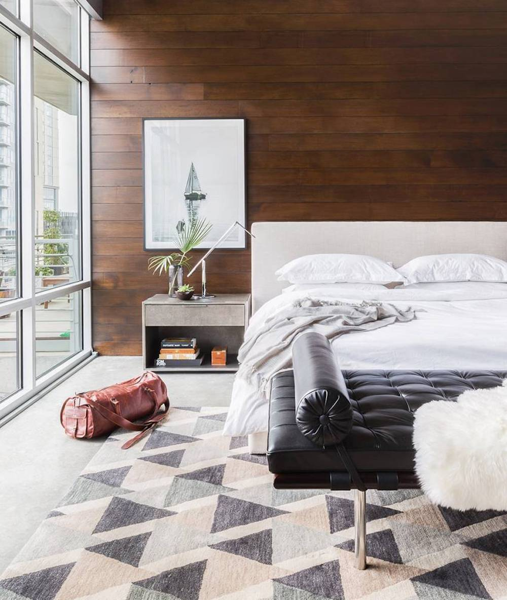 Masculine bedroom with timber clad wall || Natural timber in interiors - FIRST SENSE