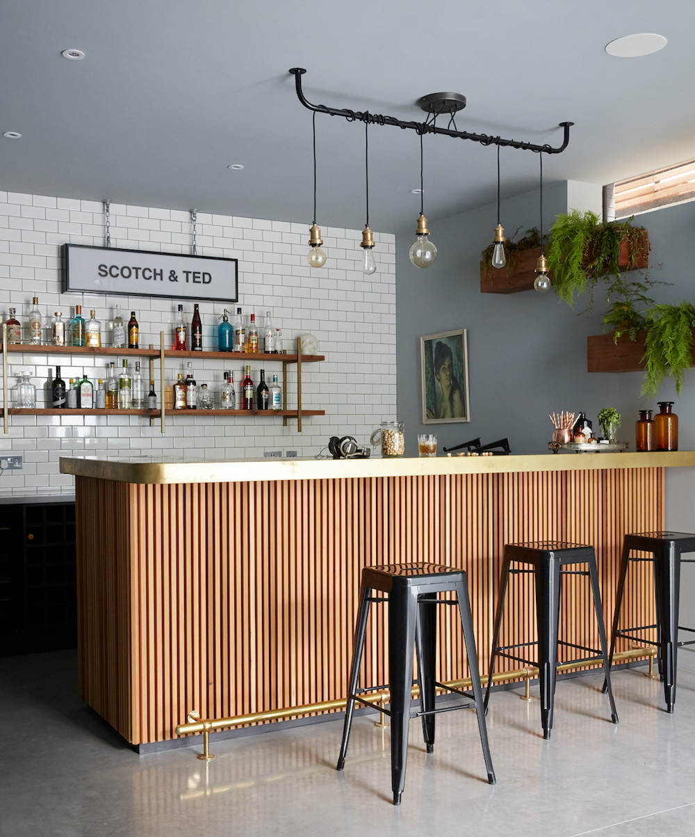 Slatted timber cladding in bar || Natural timber in interiors - FIRST SENSE