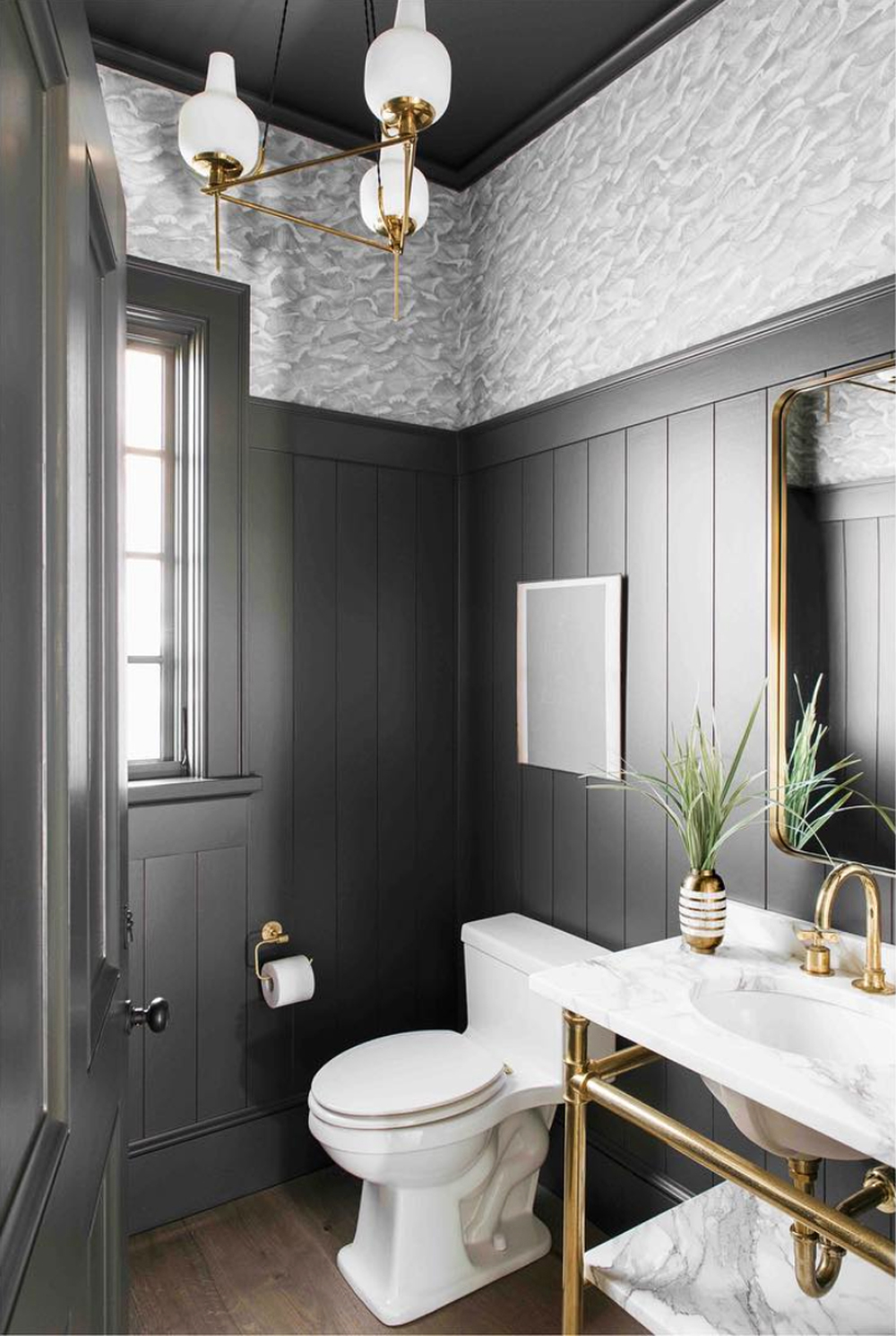 Dark powder room with shiplap and wallpaper - Cortney Bishop Design || 15 small cloakrooms / powder rooms that are big on style - FIRST SENSE