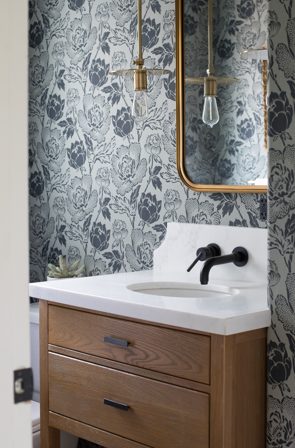 Floral wallpaper in bathroom - Britt Interiors || 15 small cloakrooms / powder rooms that are big on style - FIRST SENSE