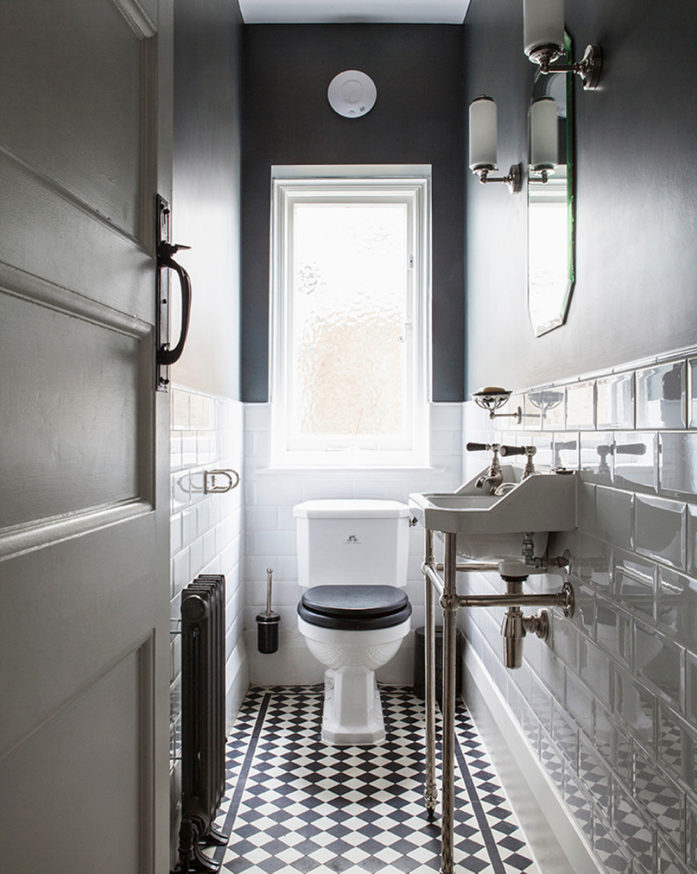 Traditional cloakroom with white metro wall tiles and chequered floor tiles - Minton Young || 15 small cloakrooms / powder rooms that are big on style - FIRST SENSE