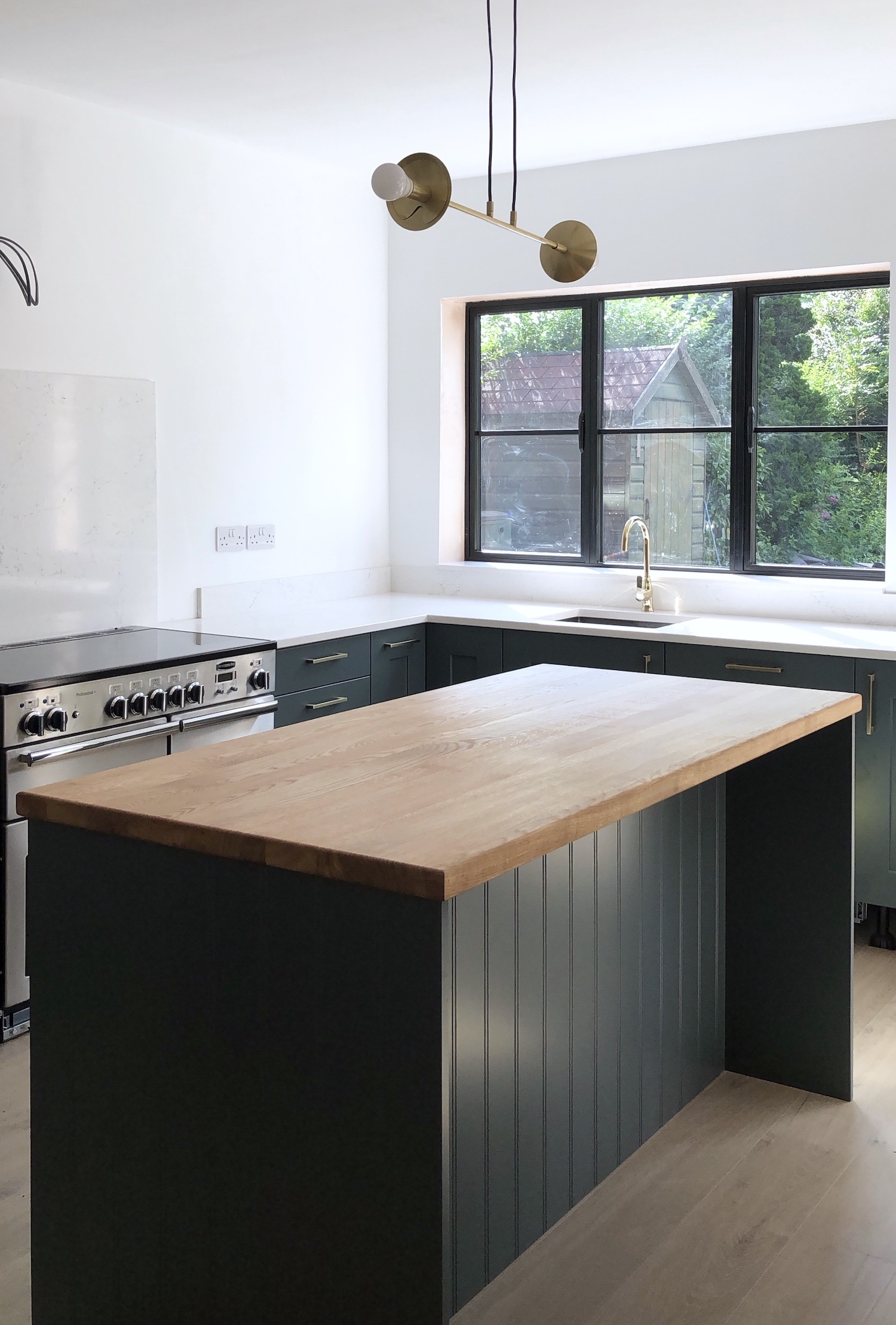 First Sense Interiors - kitchen progress - blue kitchen with quartz and oak worktops