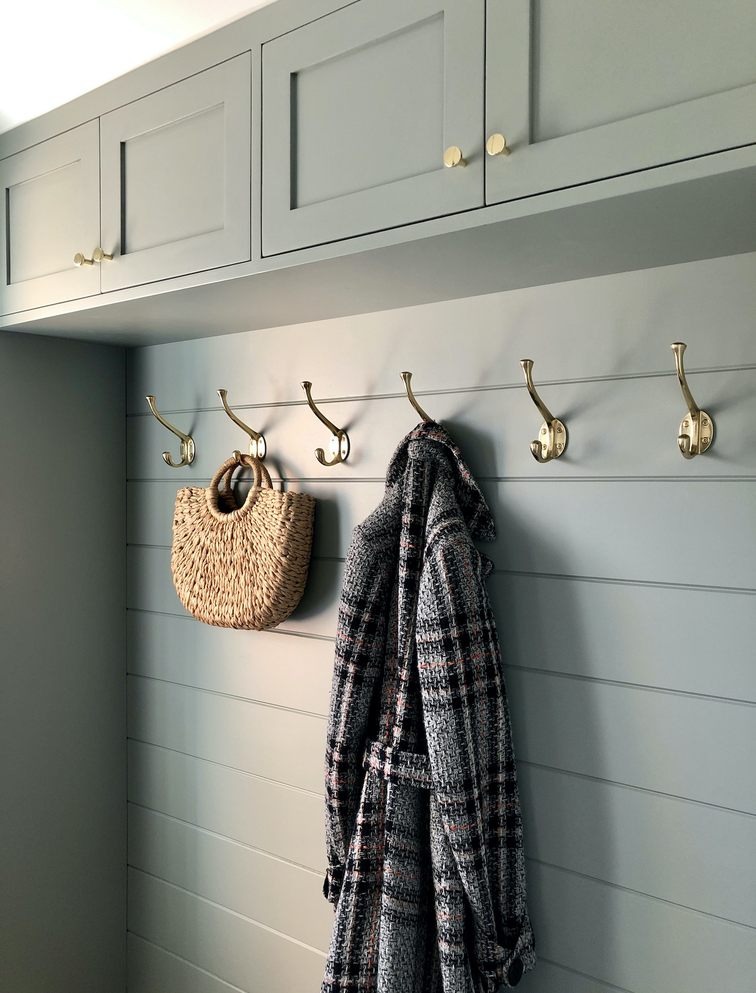 Custom boot room painted in Farrow & Ball Pigeon with solid oak seat - design by First Sense Interiors