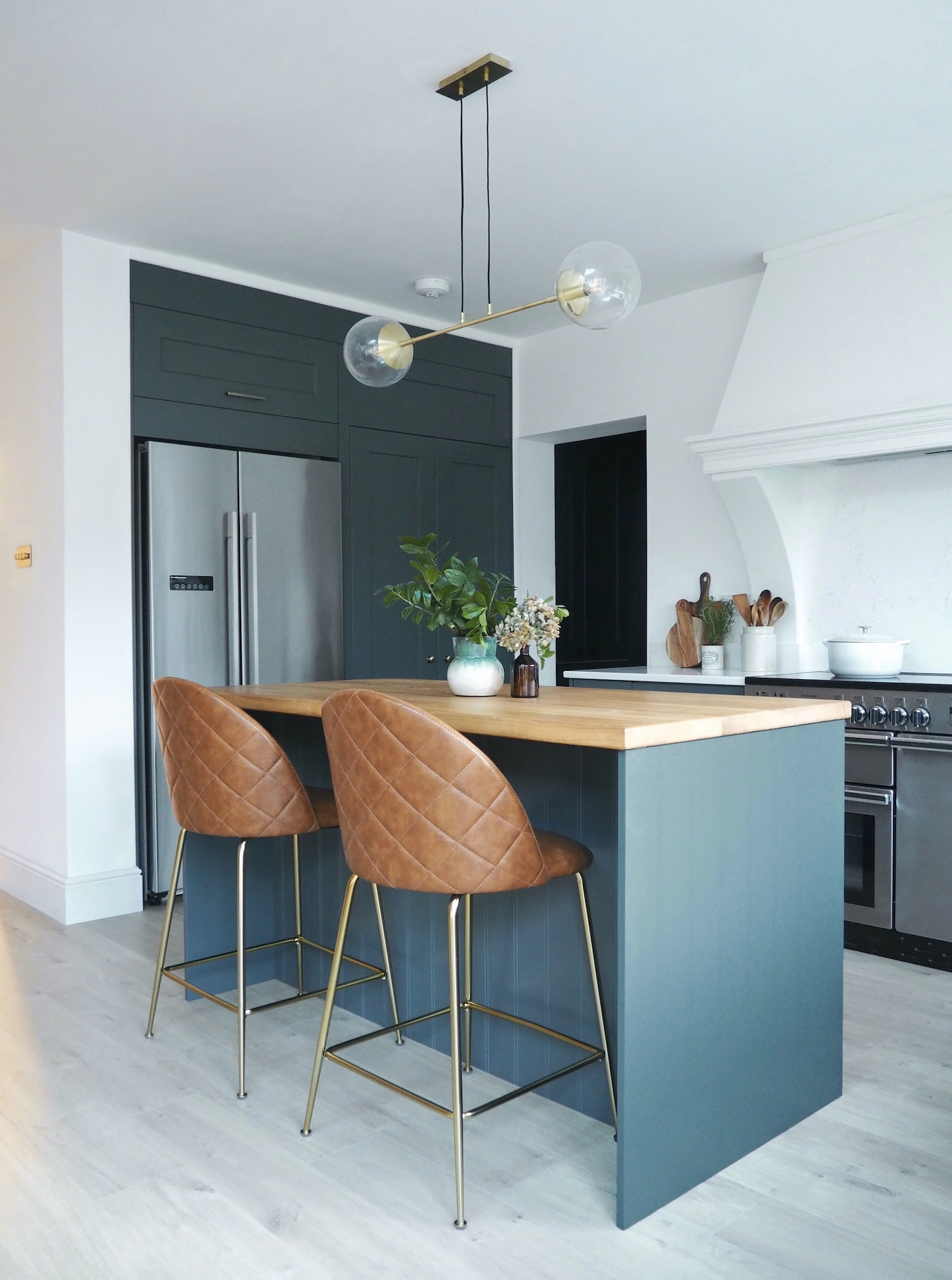 First Sense Interiors - blue shaker kitchen with secret walk-in pantry