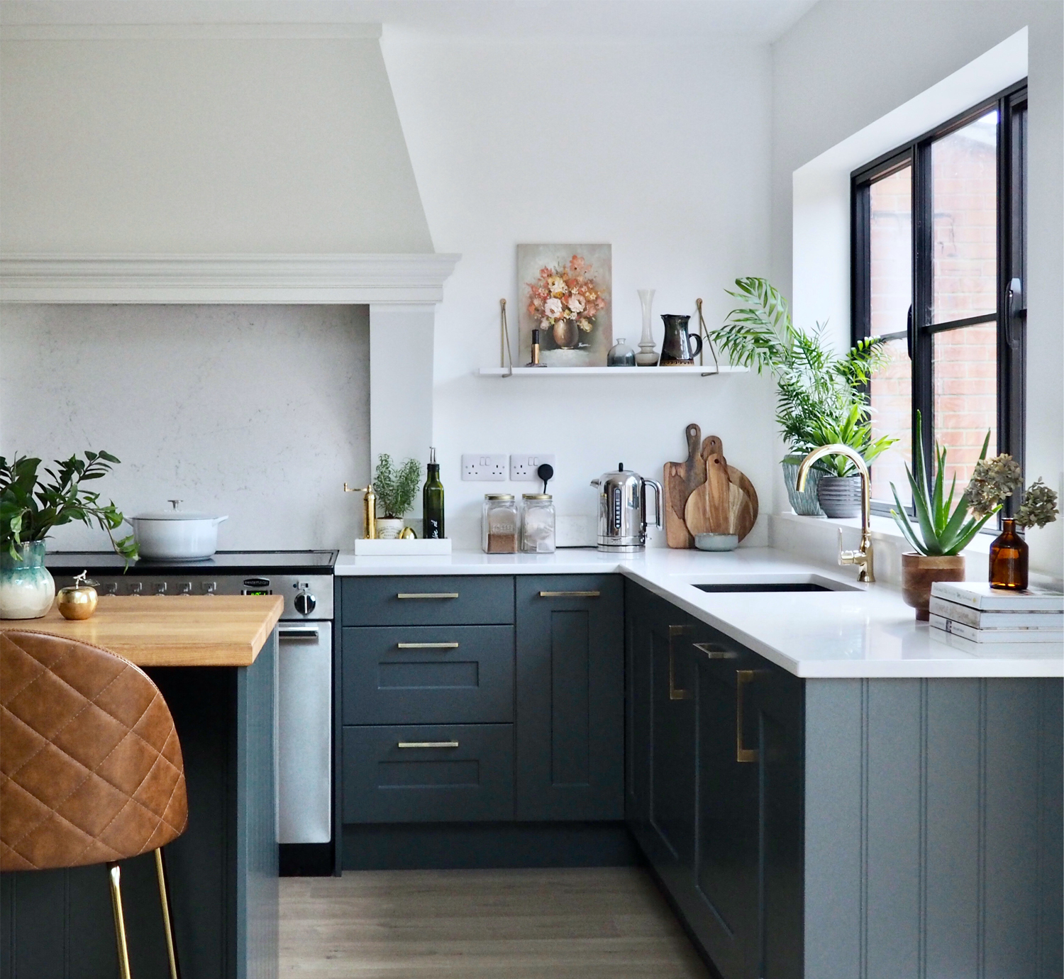 First Sense Interiors - blue shaker kitchen with brass and tan accents
