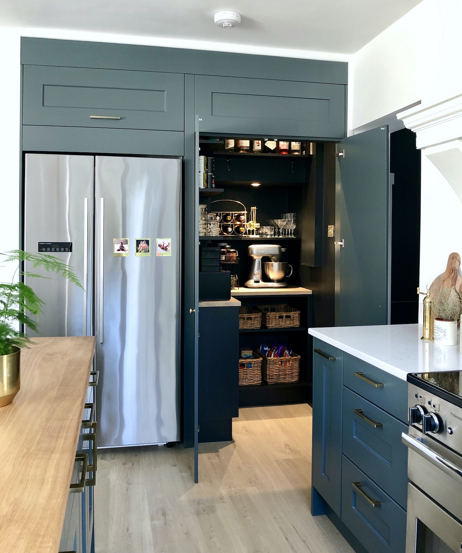 First Sense Interiors - blue shaker kitchen with hidden walk in pantry