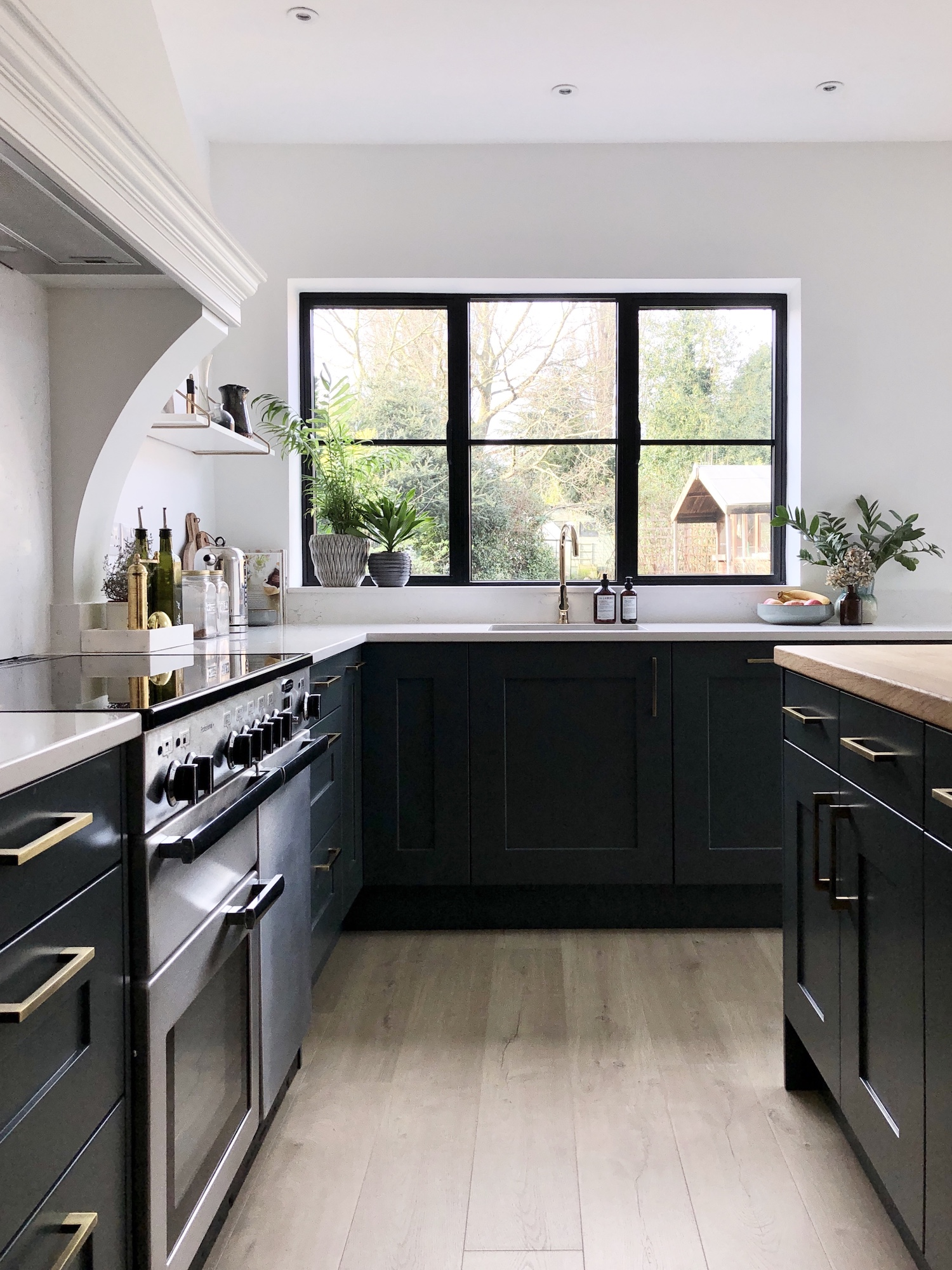 First Sense Interiors - blue shaker kitchen with induction range cooker
