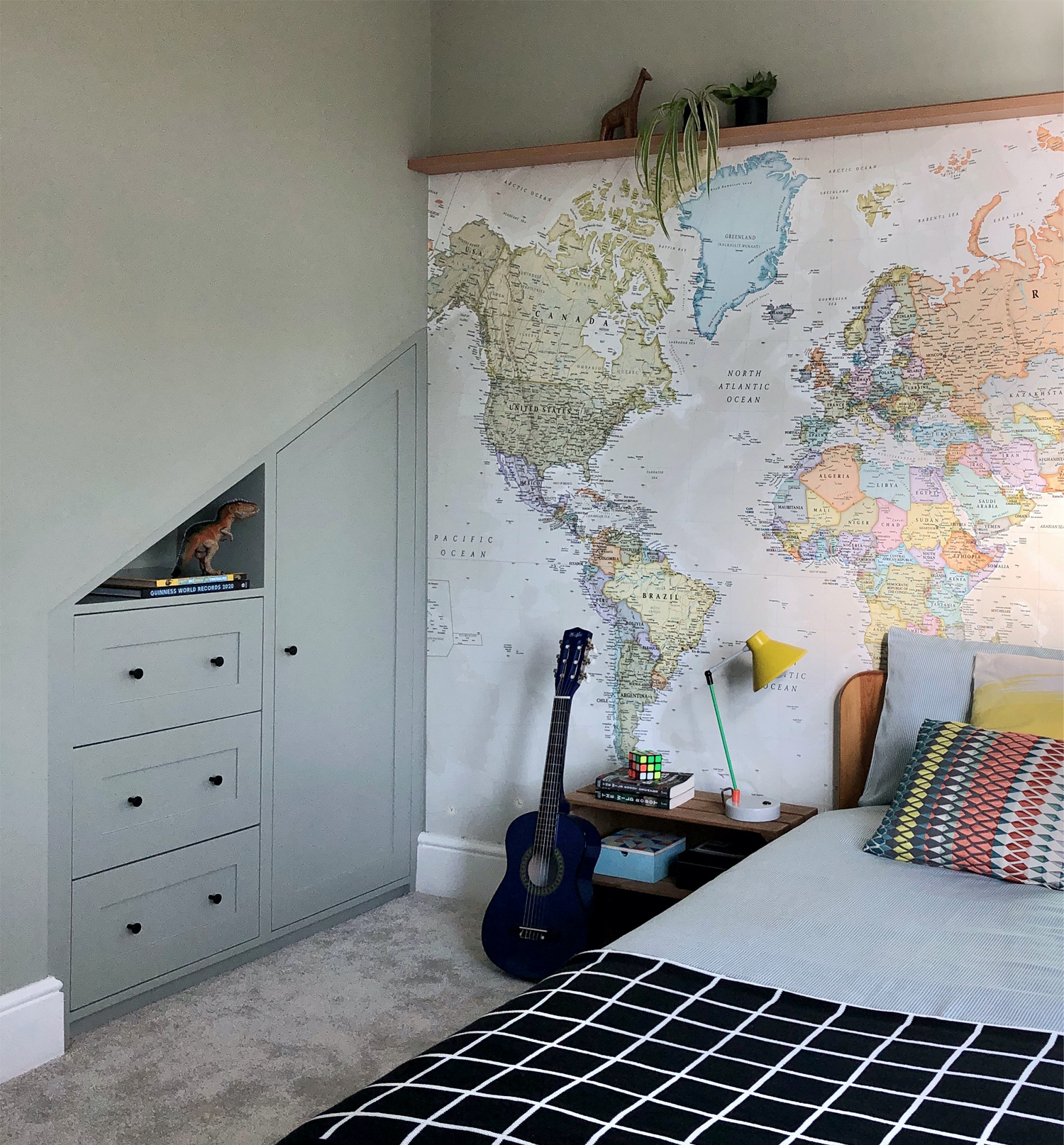 Kid's room with map wallpaper and custom built wardrobe. Design by First Sense Interiors