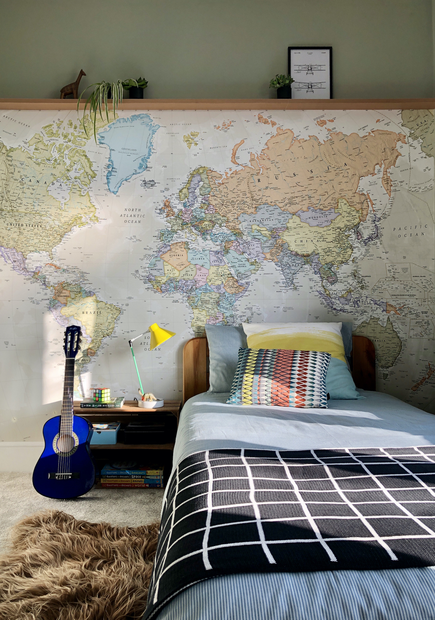 Kid's room with world map wallpaper mural from Wallsauce. Design by First Sense Interiors.