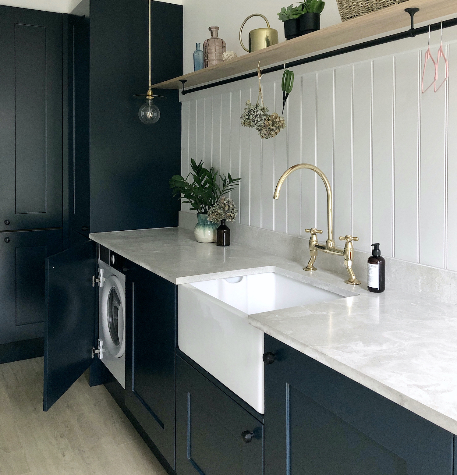 Modern-classic utility laundry mud room with dark cabinets, a Belfast sink and an oak shelf with rail