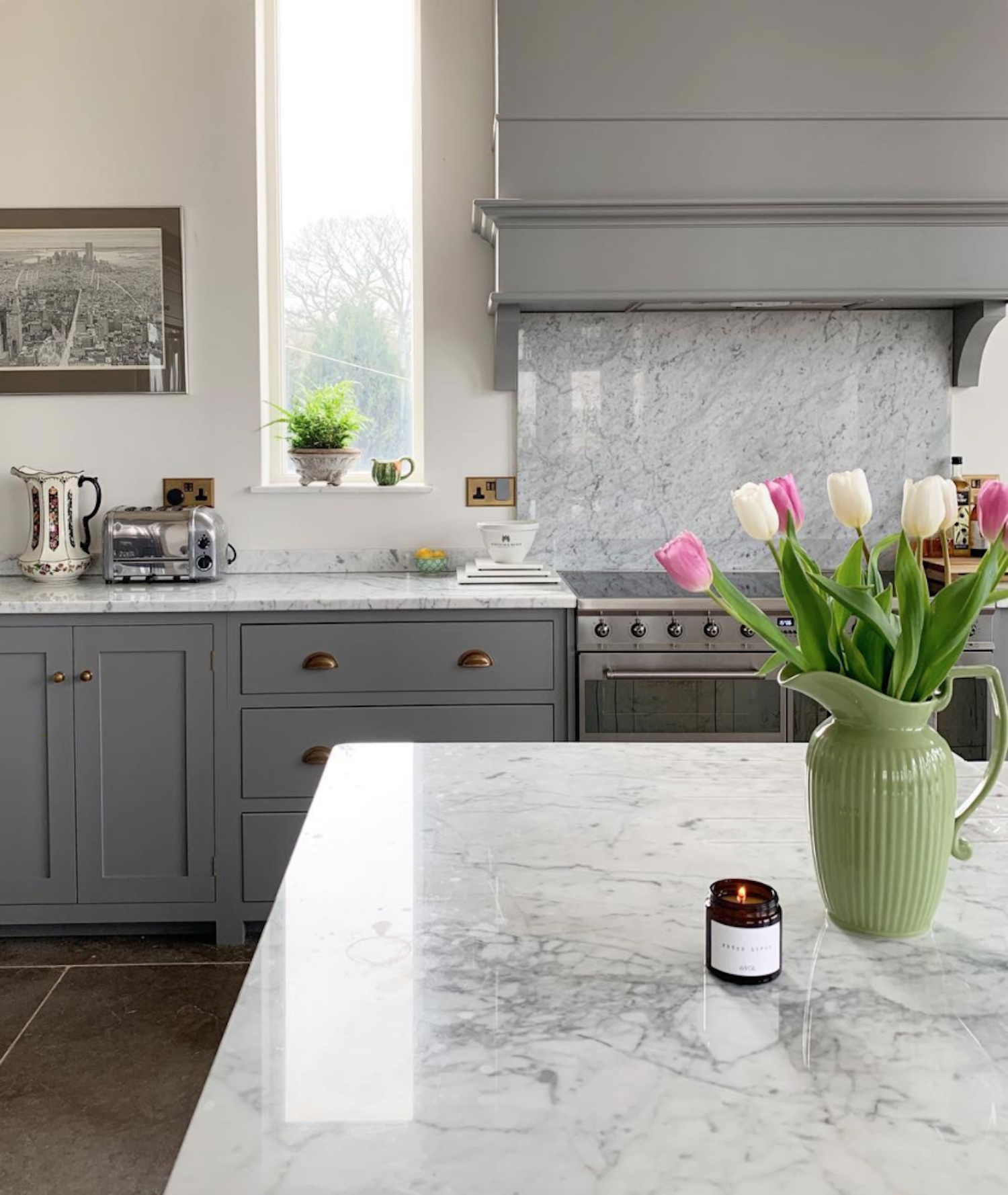 Grey kitchen with marble worktops